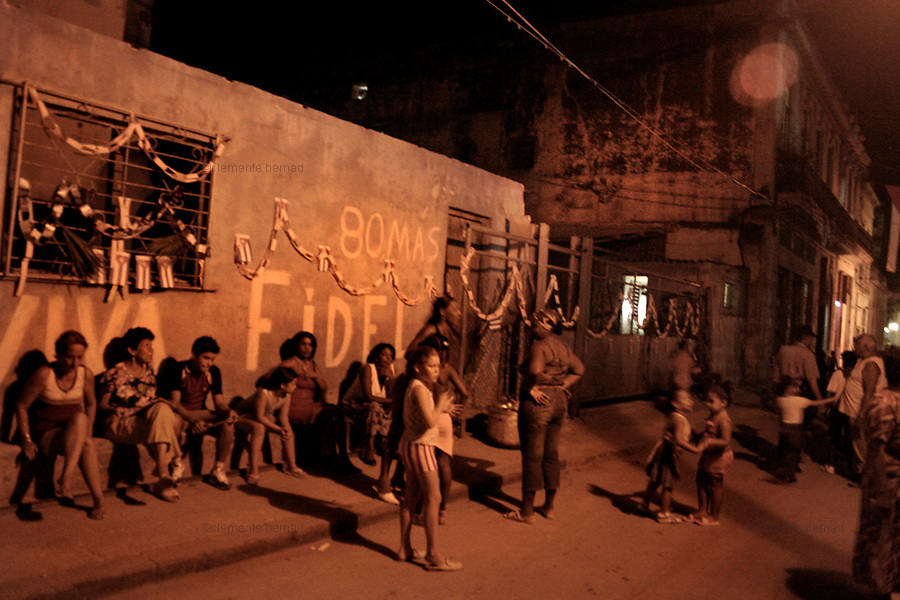 Havana (Cuba). September 2006..- La Habana Vieja. September 28th, anniversary of the CDRs (Comités de Defensa de la Revolución/ Committees for the Defense of the Revolution), in their 46th anniversary (The CDR system was formed on September 28, 1960 by Fidel Castro). People eats, drink and dance at the streets all over the country.
