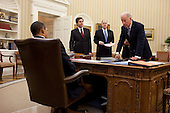 United States President Barack Obama talks with US Vice President Joe Biden, National Security Advisor Tom Donilon, center, and the Vice President's National Security Advisor Tony Blinken, left,  in the Oval Office, November 4, 2010.   .Mandatory Credit: Pete Souza - White House via CNP