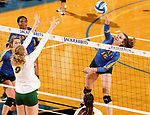 BROOKINGS, SD - OCTOBER 28: Sydney Andrews #15 from South Dakota State looks to get a kill past Emily Halverson #9 from North Dakota State during their match Sunday afternoon at Frost Arena in Brookings. (Photo by Dave Eggen/Inertia)