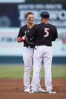 Steele Walker (left) of the Kannapolis Intimidators chats with manager Ryan Newman (5) during the game against the Rome Braves at Kannapolis Intimidators Stadium on April 4, 2019 in Kannapolis, North Carolina.  The Braves defeated the Intimidators 9-1. (Brian Westerholt/Four Seam Images)
