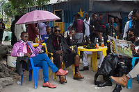 """KINSHASA, DEMOCRATIC REPUBLIC OF CONGO - FEBRUARY 10: Sapeurs take a break while paying their respect to Stervos Nyarcos, the founder of the .kitendi religion., which means clothing in local language Lingala. Nyarcos was known as the leader of the Sape movement, at Gombe cemetery on February 10, 2016 in Kinshasa, DRC. The word Sapeur comes from SAPE, a French acronym for Société des Ambianceurs et Persons Élégants. or .Society of Revellers and Elegant People. and it also means, .to dress with elegance and style"""". Most of the young Sapeurs are unemployed, poor and live in harsh conditions in Kinshasa,  a city of about 10 million people. For many of them being a Sapeur means they can escape their daily struggles and dress like fashionable Europeans. Many hustle to build up their expensive collections. Most Sapeurs could never afford to visit Paris, and usually relatives send or bring clothes back to Kinshasa. (Photo by Per-Anders Pettersson)"""