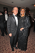 Former United States Secretary of Defense William Cohen and his wife, Janet Langhart Cohen, attend one of the parties prior to the 2002 White House Correspondent's Dinner at the Washington Hilton Hotel in Washington, DC on May 4, 2002.<br /> Credit: Ron Sachs / CNP