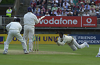 31/05/2002.Sport -Cricket - 2nd NPower Test -Second Day.England vs Sri Lanka.Mid wicket catch (Not given) [Mandatory Credit Peter Spurrier:Intersport Images]