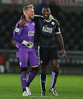Leicester City goalkeeper Kasper Schmeichel and captain Wes Morgan celebrate at full time during the Barclays Premier League match between Swansea City and Leicester City played at The Liberty Stadium on 5th December 2015