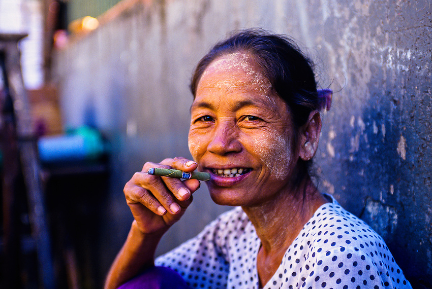 Woman smoking a cheroot, Anawrahta Street, the Indian Quarter, Yangon (Rangoon), Burma (Myanmar)