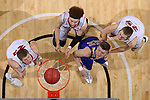 SIOUX FALLS, SD: MARCH 6: Reed Tellinghuisen of South Dakota State waits for a rebound with Tyler Peterson, Trey Burch-Manning and Tyler Hagedorn of South Dakota during the Summit League Basketball Championship on March 6, 2017 at the Denny Sanford Premier Center in Sioux Falls, SD. (Photo by Dave Eggen/Inertia)