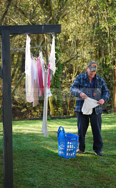 Arnold Gross hangs towels out to dry behind his shop near Quicksand, KY on October 13th, 2011. Photo by Lauryn Morris.