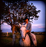 John Rott, a cattlefarmer, sits on his horse on his cattle ranch in front of a grave, Rockhampton, Australia.