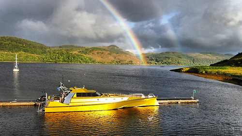 Corryvreckan at Ardbeg Marina with a rainbow as a symbol of hope for a successful trip