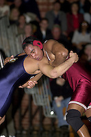 Harold Penson wrestles Adrian Garcia during a wrestling meet against UC Davis on January 19, 2001 at Burnham Pavilion.