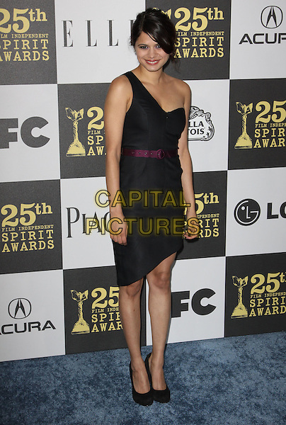 MELONIE DIAZ .25th Annual Film Independent Spirit Awards held At The Nokia LA Live, Los Angeles, California, USA,.March 5th, 2010 ..arrivals Indie Spirit full length black one shoulder strap dress hand on hip purple waist belt shoes  .CAP/ADM/KB.©Kevan Brooks/Admedia/Capital Pictures