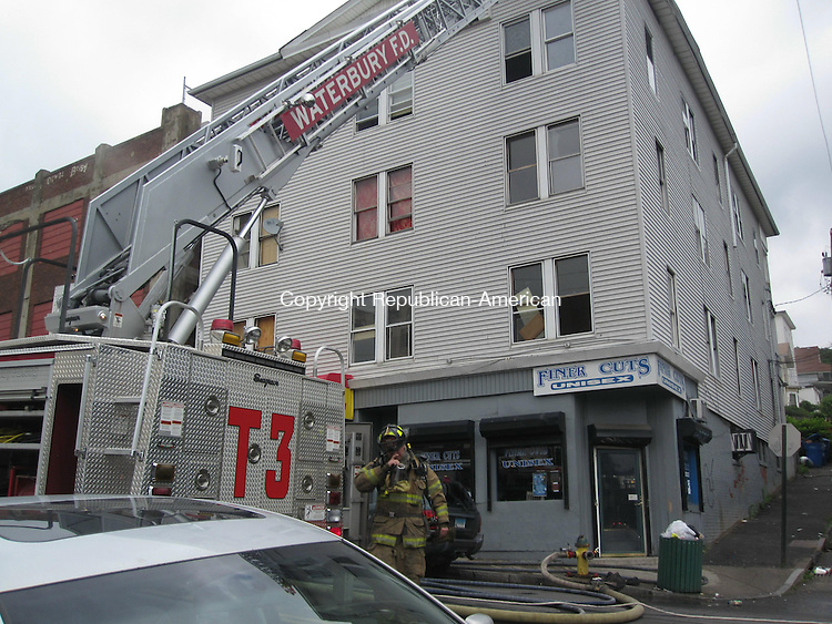 WATERBURY, CT - 13 June 2009 - 061209RA01 - A smoky fire in Apartment 2N in this building at 138 Cherry St. was quickly put out sparing the other four units and two storefronts on the first level.