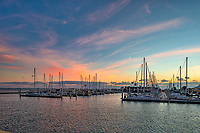 Sunrise Seascape -  We captured this photo in the early morning right before the sunrise.  I loved the sky with the colors and all the sailboats just waiting for another day to venture out on the bay.