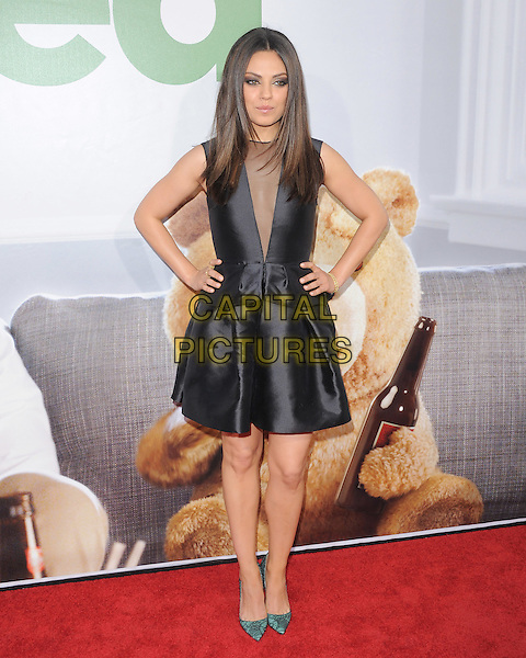 Mila Kunis.The L.A. Premiere of 'Ted' held at The Grauman's Chinese Theatre in Hollywood, California, USA..June 21st, 2012.full length black sleeveless dress sheer plunging neckline hands on hips green shoes                                                                         .CAP/RKE/DVS.©DVS/RockinExposures/Capital Pictures.