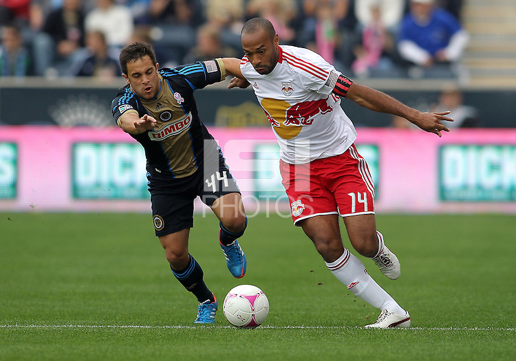 CHESTER, PA - OCTOBER 27, 2012:  Danny Cruz (44) of the Philadelphia Union tries to stop  Thierry Henry (14) of the New York Red Bulls during an MLS match at PPL Park in Chester, PA. on October 27. Red Bulls won 3-0.