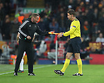 The Fourth official hands over a spare flag to referee Felix Brych during the Champions League Semi Final 1st Leg match at Anfield Stadium, Liverpool. Picture date: 24th April 2018. Picture credit should read: Simon Bellis/Sportimage