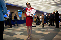 "Moscow media interview Dina Gazaliyeva,a television reporter from Tatarstan, before Russian president Vladimir Putin's annual press conference in Moscow, Russia. The woman's sign reads ""Heart Tatarstan"" and is used to get the attention of President Putin during the press conference. The woman asked Putin a question about the regional organization of Russia's territory.  Media from across the country attended the press conference."