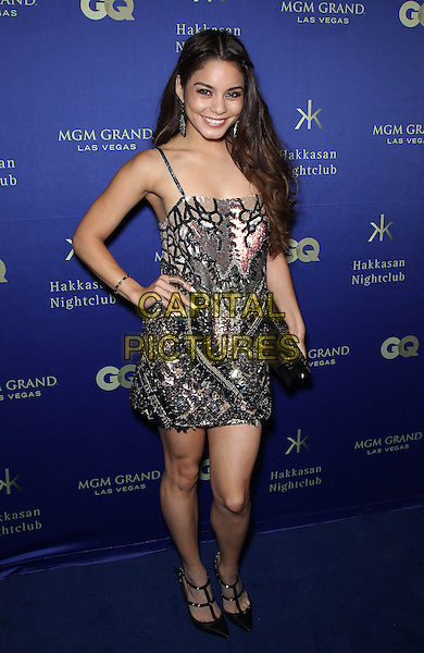 Vanessa Hudgens.At Hakkasan Las Vegas  and GQ Magazine present an all-star red carpet affair to celebrate the nightclub's Grand Opening at MGM Grand Hotel & Casino, Las Vegas, NV, USA, 27th April 2013..full length hand on hip  silver embellished dress sandals t-bar studded pointy shoes  black clutch bag sequined sequin  .CAP/ADM/MJT.© MJT/AdMedia/Capital Pictures