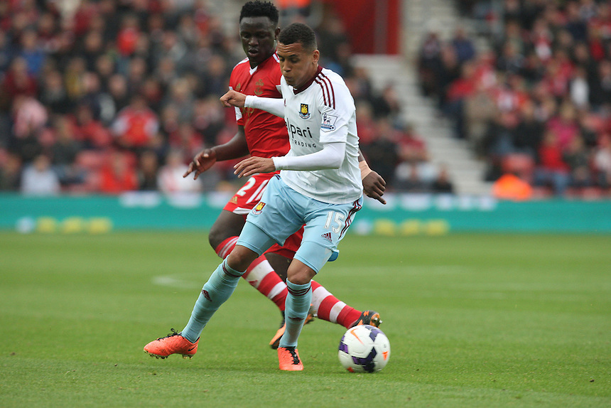 West Ham United's Ravel Morrison holds of Southampton's Victor Wanyama<br /> <br /> Photo by Kieran Galvin/CameraSport<br /> <br /> Football - Barclays Premiership - Southampton v West Ham United - Sunday 15th September 2013 -  St Mary's Stadium - Southampton<br /> <br /> &copy; CameraSport - 43 Linden Ave. Countesthorpe. Leicester. England. LE8 5PG - Tel: +44 (0) 116 277 4147 - admin@camerasport.com - www.camerasport.com