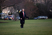 United States President Donald J. Trump walks to Marine One on the South Lawn of the White House in Washington D.C., U.S. as he departs for a Keep America Great Rally in Battle Creek, Michigan on Wednesday, December 18, 2019. The United States House of Representatives is set to vote on two articles of impeachment against him later today.<br /> <br /> Credit: Stefani Reynolds / CNP