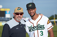 Down East Wood Ducks pitching coach Steve Mintz (13) poses for a photo with outfielder Leody Taveras (3) prior to the game against the Winston-Salem Dash at Grainger Stadium Field on May 17, 2019 in Kinston, North Carolina. The Dash defeated the Wood Ducks 8-2. (Brian Westerholt/Four Seam Images)