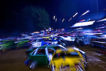 An in-camera zoom blur of this demoliton derby at the 2007 Montgomery County Agricultural Fair was created by zooming the camera lens while pressing the shutter button.  A slower shutter speed is required to capture the zoom effect.  In this image, a shutter speed of 1/3 second was used.
