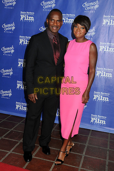 Julius Tennon, Viola Davis.Attending the 27th Annual Santa Barbara Film Festival - Outstanding Performer of The Year Award Presented to Viola Davis held at the Arlington Theatre, Santa Barbara, California, USA, 27th January 2012.full length sleeveless pink mid length dress  black open toe sandals couple husband wife black suit  red tie .CAP/ADM/BP.©Byron Purvis/AdMedia/Capital Pictures.