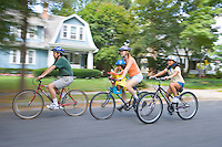 Family on bike ride along the streets of Moorestown, New Jersey