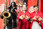 Burger King Japan President, Yasuyuki Murao poses for the cameras with Kuro Shogun (left) and Aka Samurai (right) during the new Burger King's red burgers launching event on July 3, 2015, in Tokyo, Japan. The two new burgers ''AKA SAMURAI CHICKEN'' and ''AKA SAMURAI BEEF'' use red buns and red cheese, colored by tomato powder and spicy red sauce and will be sold at Japanese branches until August. The AKA SAMURAI CHICKEN costs 540 JPY (4.39 USD) and the AKA SAMURAI BEEF costs at 690 JPY (5.61 USD). As a part of the promotion Burger King plans to launch two new black burgers on August 21st. (Photo by Rodrigo Reyes Marin/AFLO)