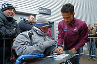 Wayne Routledge of Swansea City signs an autograph for a fan as he arrives prior to the game during the Sky Bet Championship match between Preston North End and Swansea City at Deepdale, Preston, England, UK. Saturday 12 January 2019