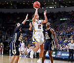 SIOUX FALLS, SD: MARCH 5: Kerri Young #10 from South Dakota State University lays the ball up past Ashley Beatty #23 and Faith Ihim #15 from Oral Roberts during the Summit League Basketball Championship on March 5, 2017 at the Denny Sanford Premier Center in Sioux Falls, SD. (Photo by Dave Eggen/Inertia)