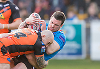 Picture by Allan McKenzie/SWpix.com - 11/03/2018 - Rugby League - Betfred Super League - Castleford Tigers v Salford Red Devils - the Mend A Hose Jungle, Castleford, England - Salford's Luke Burgess is tackled by Castleford's Nathan Massey.