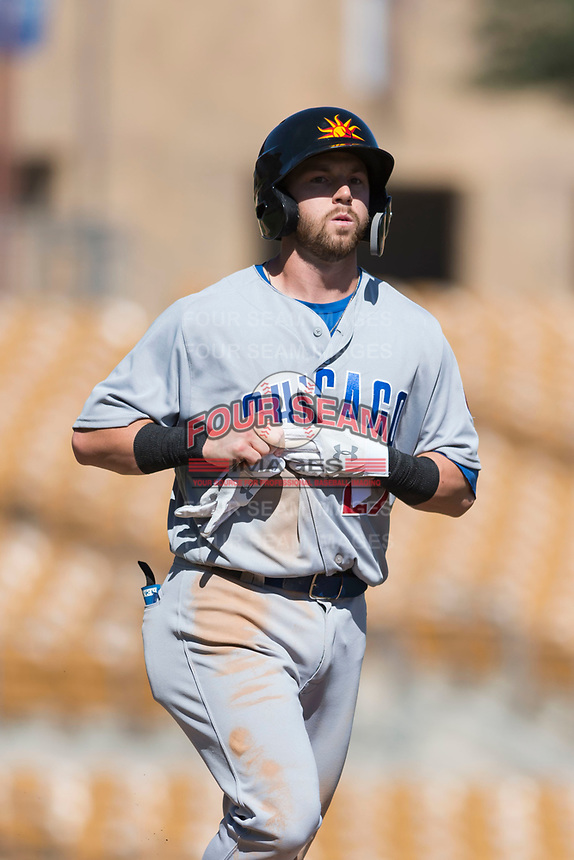 Mesa Solar Sox right fielder Trent Giambrone (27), of the Chicago Cubs organization, jogs towards first base after drawing a walk during an Arizona Fall League game against the Glendale Desert Dogs at Camelback Ranch on October 15, 2018 in Glendale, Arizona. Mesa defeated Glendale 8-0. (Zachary Lucy/Four Seam Images)