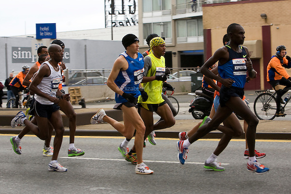 The front pack of Men's Elite runners, including Robert Kipkoech Cheruiyot (rt), Ryan Hall (c), and Hendrick Ramaala (2nd row, c) as they approach Mile 7 in the ING New York City Marathon.