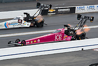 Feb 10, 2019; Pomona, CA, USA; NHRA top fuel driver Leah Pritchett (near) races alongside teammate Antron Brown during the Winternationals at Auto Club Raceway at Pomona. Mandatory Credit: Mark J. Rebilas-USA TODAY Sports