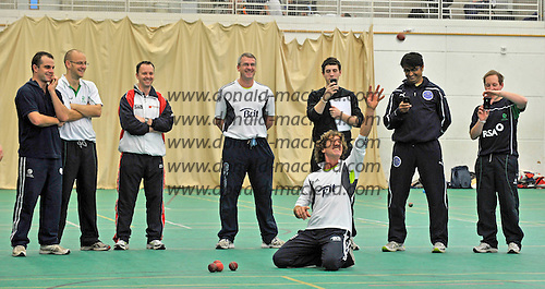"""While his usual """"pupil"""" Matt Prior is taking part in the Ashes series in Australia, England wicket-keeping coach Bruce French, kneeling, works on cricket techniques with coaches as part of the European ECB Level 3 Coaching Course 2011 at the Scotland National Cricket Academy, Edinburgh, hosted for the first by Cricket Scotland. Nineteen coaches from all over Europe, including six from Scotland, are at the Mary Erskine Cricket Centre for a week, under the auspices of the Pepsi ICC Development Programme, to be taken through coaching routines as part of their education programme leading the ECB Level 3 Qualification exams later in this year - Picture by Donald MacLeod 06.01.11 - mobile 07702 319 738 - clanmacleod@btinternet.com"""