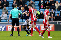 Referee Stuart Attwell gets ready to show a yellow card to Millwall's Tim Cahill during Millwall vs Brentford, Sky Bet EFL Championship Football at The Den on 10th March 2018