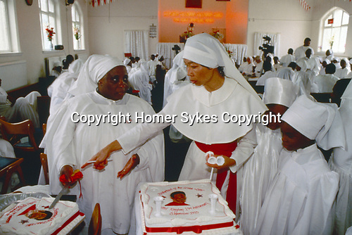 Brotherhood of the Cross and Star. Church service Manchester.  A birthday cake with image of OOO Olumba Olumba Obu. A STORM IS PASSING OVER a Look at Black Churches in Britain. Published by Thames and Hudson isbn 0 500 27826 1