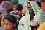 A Rohingya man, having just crossed the border from Myanmar, waits to complete registration in the Kutupalong Refugee Camp near Cox's Bazar, Bangladesh.<br /> <br /> More than 600,000 Rohingya have fled government-sanctioned violence in Myanmar for safety in Bangladesh.