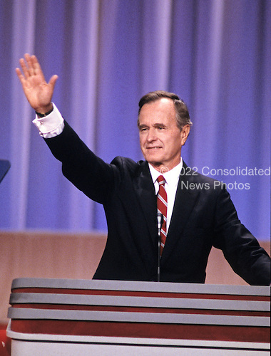 United States Vice President George H.W. Bush waves to the crowd from the podium as he delivers his speech accepting his party's nomination for President of the United States at the 1988 Republican Convention at the Super Dome in New Orleans, Louisiana on August 18, 1988.<br /> Credit: Arnie Sachs / CNP