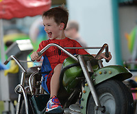 NWA Democrat-Gazette/ANDY SHUPE<br /> Bruce Dourth, 5, of Bentonville laughs Friday, Aug. 9, 2019, during the 121st Tontitown Grape Festival in Tontitown. The festival, which features crafts vendors, chicken and spaghetti dinners and a midway, continues through today.