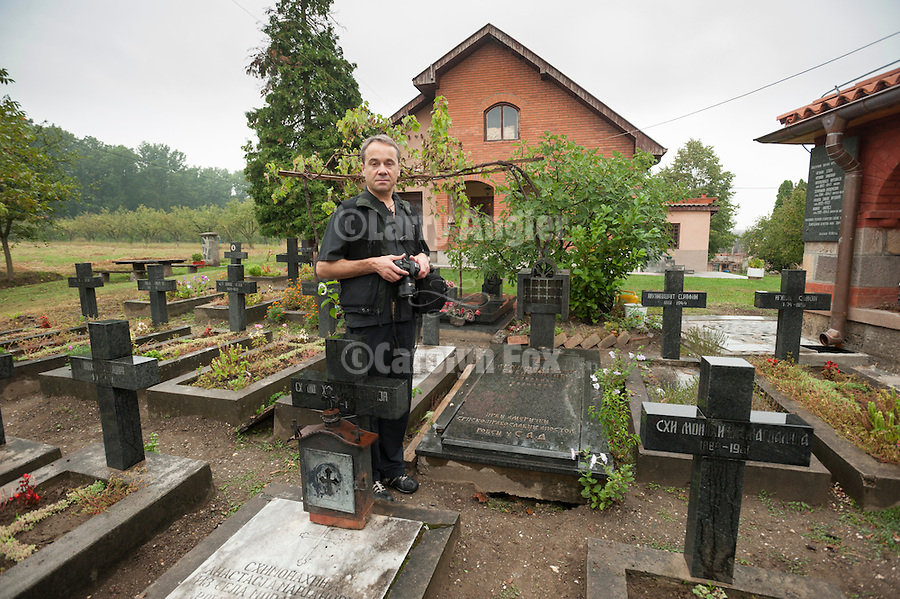Miloje Milinkovic at the Sebastian Dabovich grave in the cemetery at Zica Monastery, .The Red monastery--Gravesite of Sebastian Dabovich, founder of St. Sava Church, Jackson, Calif. His relics are interred in Jackson...The monastery was founded by King Stefan Prvovencani, the First-Crowned, and built in the early 13th century and received St. Sava as the first Patriarch of the Serbian Orthodox Church in 1219. The monastery was burned in a raid near the end of the 13th century and was subsequently deserted. Multiple renovations were carried out during the late 13th and early 14th centuries. The most complete renovations were completed during the rein of King Milutin (1282-1321)..Nikolai Velimirovic was consecrated Bishop of Zica in 1919. Zica suffered damage during World War II which Bishop Nikolai was unable to restore, because of his arrest there in 1941. After the war Zica became a woman's monastery. Zica celebrated its 800th anniversary in 2005.