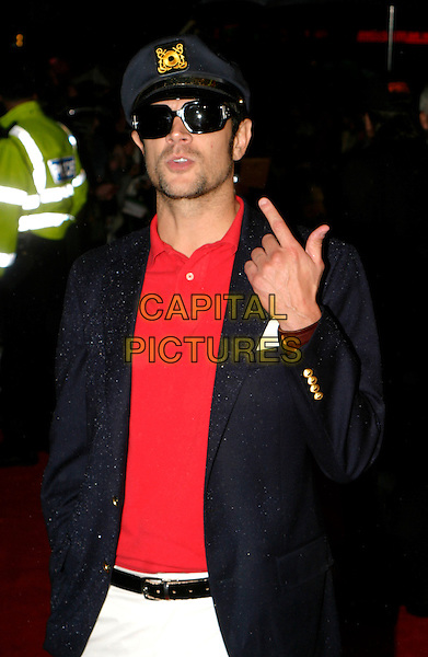 "JOHNNY KNOXVILLE.""The Dukes Of Hazzard"" UK Film Premiere, Vue Leicester Square, London..August 22nd, 2005.half length sunglasses shades hat blue jacket uniform captain red shirt finger pointing gesture.www.capitalpictures.com.sales@capitalpictures.com.© Capital Pictures."