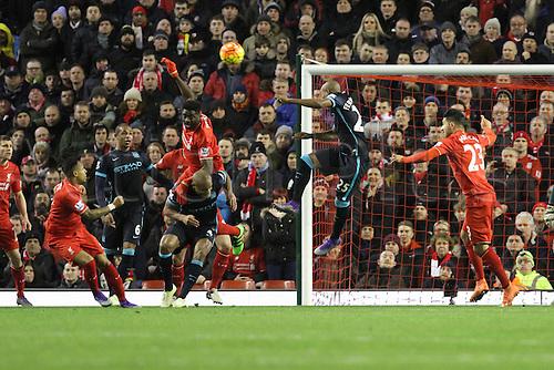 02.03.2016. Anfield Stadium, Liverpool, England. Barclays Premier League. Liverpool versus Manchester City. Kolo Toure of Liverpool heads clear a dangerous cross
