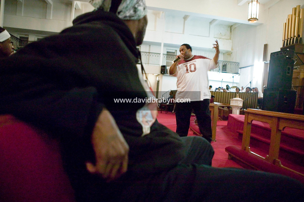 New York, USA - Reverend Darren Ferguson (R) preaches during mass at the Greater Hood Memorial AME Zion Church, home of the Hip-Hop Church, in Harlem, New York, USA, 24 March 2005. Photo Credit: David Brabyn.