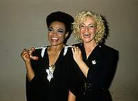 "Montreal (Qc) CANADA - August 8,1986 File Photo -<br /> <br /> Eartha Kitt (L) concert with Marjo (R) in Montreal.<br /> <br /> Eartha Mae Kitt (born on January 17, 1927)[1] is an American actress, singer, and cabaret star. She is known for her role as Catwoman in the 1960s TV series Batman, and for her 1953 Christmas song ""Santa Baby."" Orson Welles once called her ""the most exciting woman in the world."".<br /> <br /> Marjol??ne Morin (born 2 August 1953 in Montreal, Quebec), professionally known as Marjo, is a francophone Canadian singer-songwriter. After singing in two musicals of Fran??ois Guy, Marjo joined the band Corbeau in 1979, two years after the group was started by Pierre Harel.<br /> <br /> Her solo career began shortly after Corbeau disbanded with the theme song for the film La Femme de l'h??tel which earned a Genie Award for Best Original Song in 1985. In 1986, her debut album Celle qui va sold more than 250 000 copies.<br /> <br /> -Photo (c)  Images Distribution"