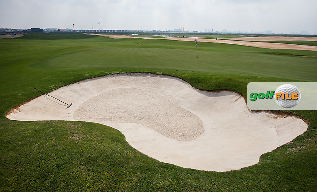 View of the left-side bunker to the 1st at Al Zorah Golf Club, Dubai, United Arab Emirates.  26/01/2016. Picture: Golffile | David Lloyd<br /> <br /> All photos usage must carry mandatory copyright credit (&copy; Golffile | David Lloyd)