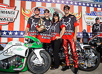 Sept. 2, 2013; Clermont, IN, USA: NHRA pro stock motorcycle rider John Hall celebrates with team owner Matt Smith and crew after winning the US Nationals at Lucas Oil Raceway. Mandatory Credit: Mark J. Rebilas-