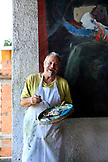 BRAZIL, Rio de Janiero, Bob Nadkarni with one of his paintings above Favela Tavares Bastos