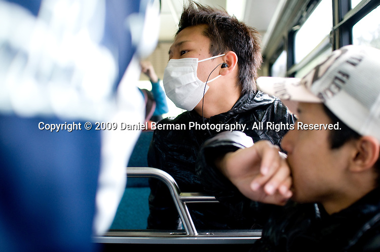 "Ryo T., 20, an international student at a college in north Seattle, wore a face mask to school to allay health concerns. Says Ryo, ""I'm scared I'll get swine flu. I'm scared I'll get sick."""
